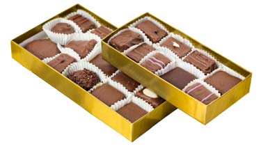 Assorted chocolates in a gold box.