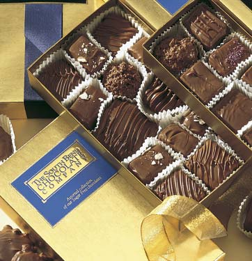 Assorted sugar-free chocolates in a gold box.