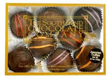 Assorted truffles hand dipped in milk chocolate.