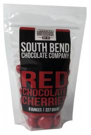 Dried Michigan cherries coated in milk chocolate, then covered in a red sweet cherry coating.