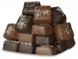 Caramel squares covered in dark chocolate topped with sea salt.
