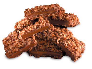 Toffee bars covered in chocolate covered in diced pecans.