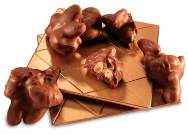 Fresh roasted almonds covered in milk chocolate.