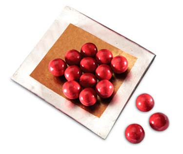 Malted milk ball center coated in milk chocolate and then covered in a cherry coating.