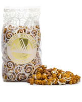 Caramel corn with cinnamon and drizzled with white chocolate and fresh roasted cinnamon almonds.
