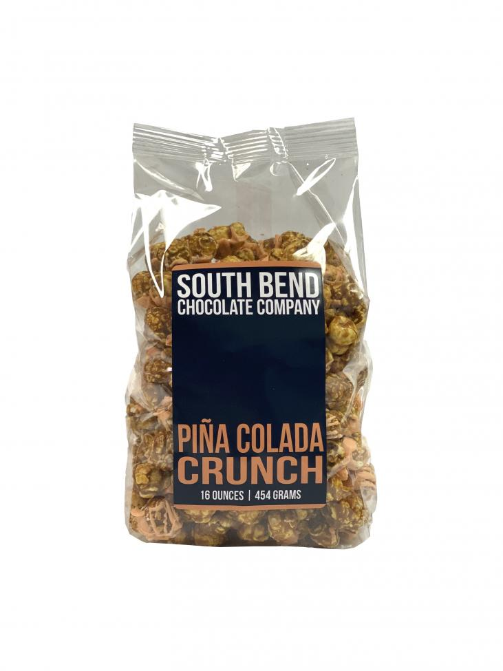 Pina colada flavored caramel corn drizzled with chocolate and sprinkled with coconut.